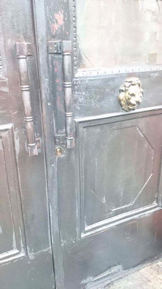 Неизвестные ночью подожгли двери Института национальной памяти