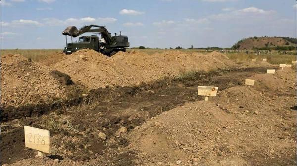 В Донбассе в поле нашли кладбище террористов - батальон Киев-1